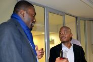 Community member Ekerete chatting to Fred Swaniker